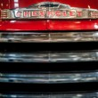 Radiator grille of red vintage Chevrolet — Stock Photo #64499545