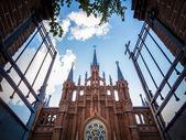 Open gate towards an Christian church — Stock Photo