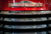 Radiator grille of red vintage Chevrolet — Stock Photo