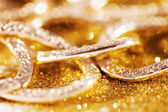 Gold jewelery luxury background — Stock Photo