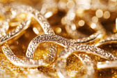 Gold jewelery luxury background. golden glitter — Stock Photo
