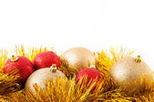 Red and golden Xmas decoration, isolated over white. — Stock Photo