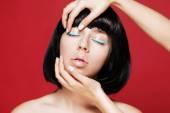 Glamourous closeup asian female portrait. Fashion eyeliner makeup on model eyes. Cosmetics and make-up. — Stock Photo