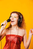 Young happy woman with microphone. Singer. Karaoke — Stock Photo