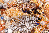 White and yellow gold jewelry background. — Stock Photo