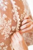 Bride putting on her white wedding dress — Stock Photo