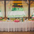 Wedding reception area ready for dinner and the party — Stock Photo #69228005