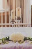 White wedding candles with beautiful lavanda flowers — Stock Photo