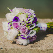 Close up of brides bouquet with colorful flowers on wedding day — Stock Photo #77739520