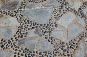 Old natural stone pavement background — Stock Photo