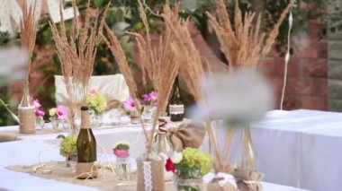 Set table and chairs outside in the grass, organizations invited — Stock Video