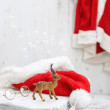 Reindeer With Santa Hat — Stock Photo #57689909