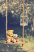 Teddies On Rustic Swing — Stock Photo