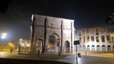 Arch of Constantine and Colosseum at night. Rome. Italy — Стоковое видео