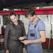 Garage worker and client — Stock Photo #51827493