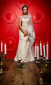 Bride  with vintage candles — Stock Photo