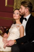 Newlyweds in a luxurious interior — Stock Photo