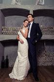 Happy newlyweds in room — Stock Photo