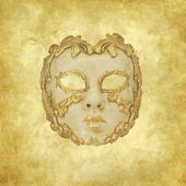 Golden decorated Venetian mask on a floral grunge background — Stock Photo