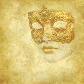 Golden Venetian mask on floral grunge texture — Stock Photo