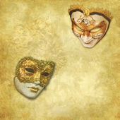 Two Venetian masks on a rich golden textured background — Stock Photo