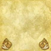 Two golden vintage Venetian masks on a rich decorated golden texture — Stock Photo
