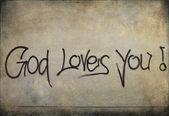 Graffiti: God loves you! on a wall — Stock Photo