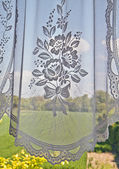 Window with lace curtain — Stok fotoğraf