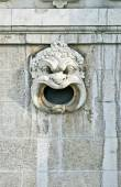 Old marble mask as ornament on a facade — Stock Photo