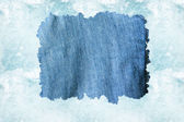 Denim cloth against a light blue water background — Stock Photo