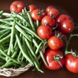 Raw vegetables harvest, green beans and tomatoes — Stockfoto #55310187