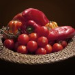 Basket with red bell peppers and cherry tomatoes — Stock Photo #55310541