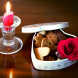 A cookies heart shaped box, a candle and a rose — Стоковое фото #55314681