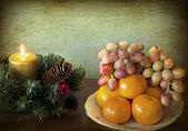 Grunge Christmas with fruits — Stock Photo