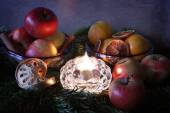 Christmas:a candle, fir branches spices and fruits — Stock Photo