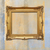 Baroque golden frame on a grunge faded texture — Stock Photo