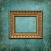 Classical gold frame on a grunge Victorian wallpaper — Stock Photo