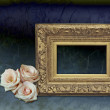 Velvet blue vintage background with golden empty frame and three — Stock Photo #56125023