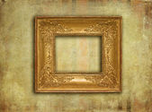 Golden vintage frame on grunge texture — Stock Photo