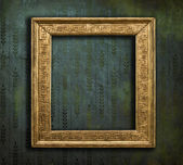 Classical golden frame on faded grunge texture — Stock Photo