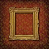 Gold baroque frame on a red damask Victorian wallpaper — Stock Photo