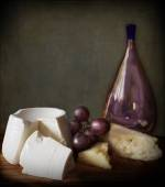Chiaroscuto still life with grapes,cheese and bottle — Stock Photo
