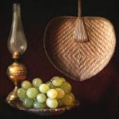 Still life, grapes, oil lamp and fan — Stock Photo