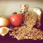 Soup ingredients: fresh tomato, garlic,onion, borlotti beans, emmer on the kitchen table — Stock Photo #56693269