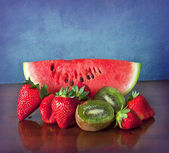 Summer fruits on wooden desk — Stock Photo