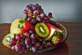 Fresh and exotic fruits on the kitchen table — Stock Photo