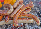 Sausages grilled on portable barbecue outdoor — Stockfoto