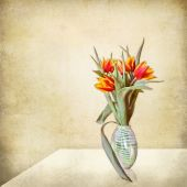 Grunge stil life, vase of tulips on a table — Stock Photo