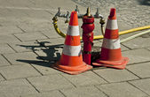 Street hydrant with traffic cones — Stock Photo