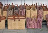 Straw bags at open air market — Stok fotoğraf